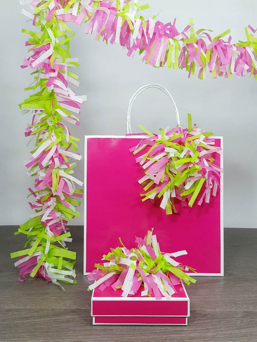 Tissue paper garland looks great on party favors, gift bags and boxes too!
