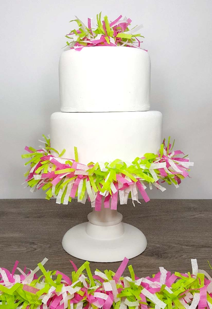 Use your colourful tissue paper garland to decorate your next party, shower or event. You can even use it on your cake!
